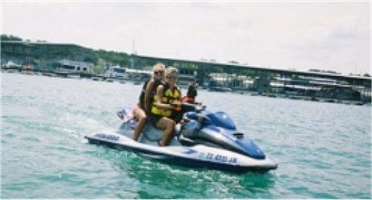 Isabelle the Silky Terrier is sharing a Jet Ski with two Women