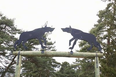 iron wolf silhouettes over a wooden entrance way