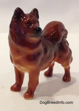 A Chow Chow figurine that is in a standing pose. The figurine has fine eye details.