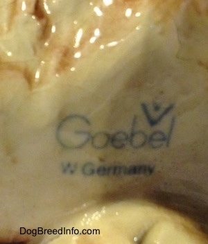 Close up - The underside of a porcelain Chow Chow figurine that has the stamp of a Goebel W.Germany logo.